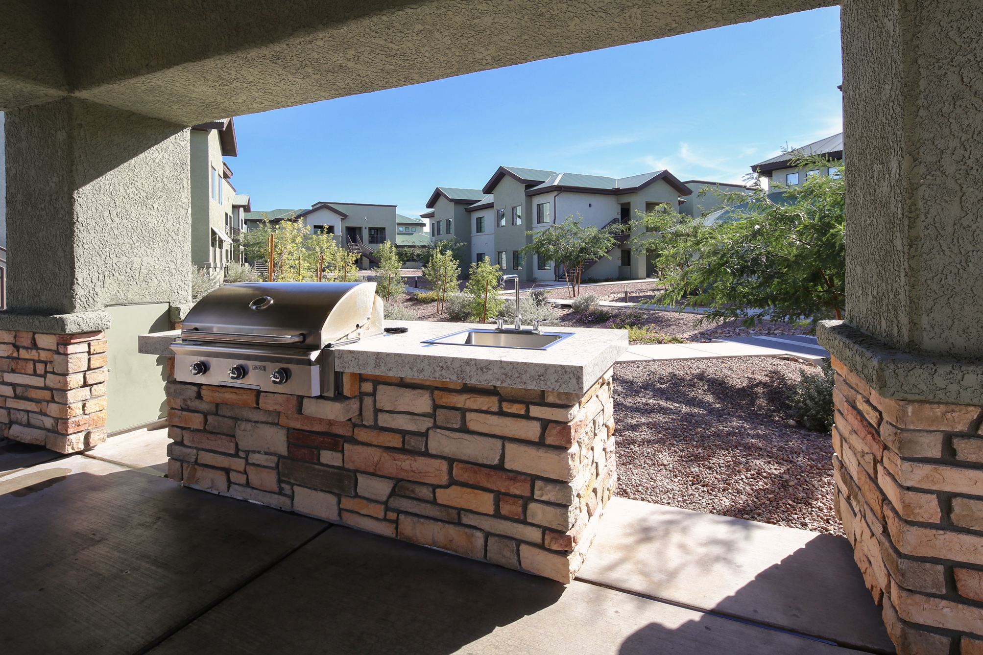 Beautiful outdoor gathering spaces with cooking stations and fireplace