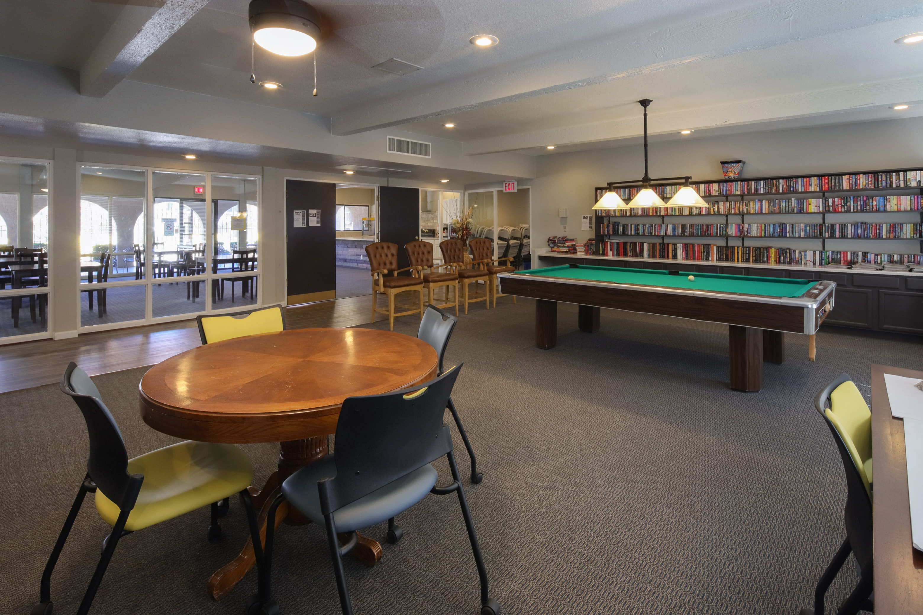 Renovated clubhouse with gathering space, billiards, full hosting kitchen, sauna and full gym and fitness center